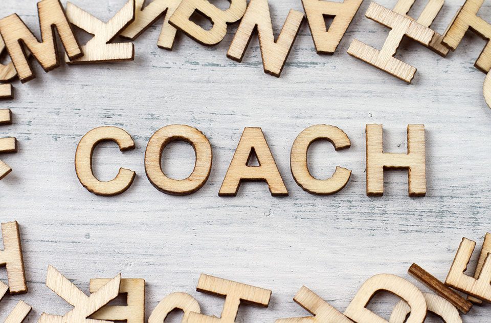Coach made out of wood letters.